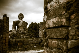 This serene Buddha is what remained from Wat Phia after the heavily bombing of Laos during 1964 and 1973. (Muang Khoun, Laos)