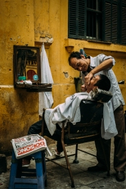 So, that's the way a haircut and shaving is done here in Vietnam. Call me whatever you will, but the closer I look at this picture the more I am convinced to recognize a subtle grin on the barbers face.(Hanoi, Vietnam)
